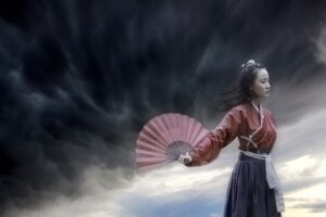 ChineseWoman-with-a-fan-Is China-A-Paper-Dragon