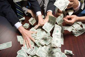 usinesspeople grabbing money